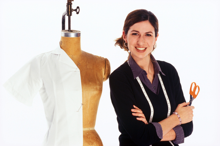 Seamstress standing next to mannequin